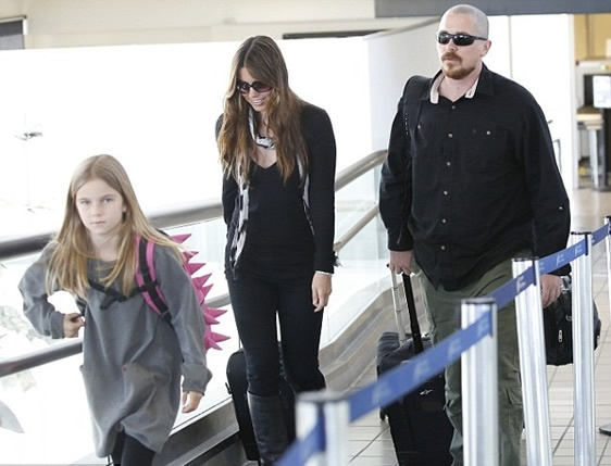Christian Bale with belly and peeled at the Los Angeles International Airport