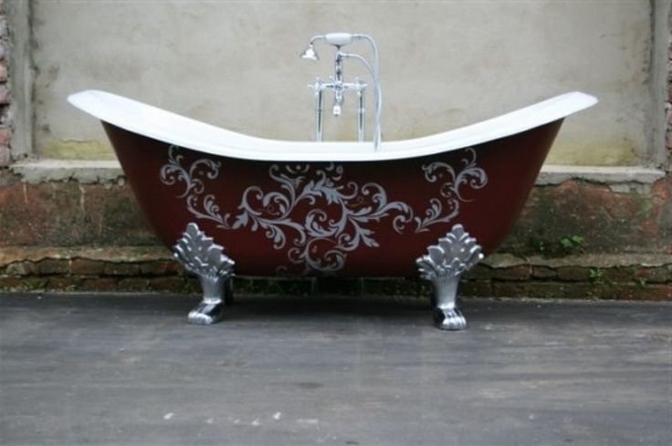 This double ended slipper lions paw foot bathtub has kicked it up a notch with an interesting painted design on the side.