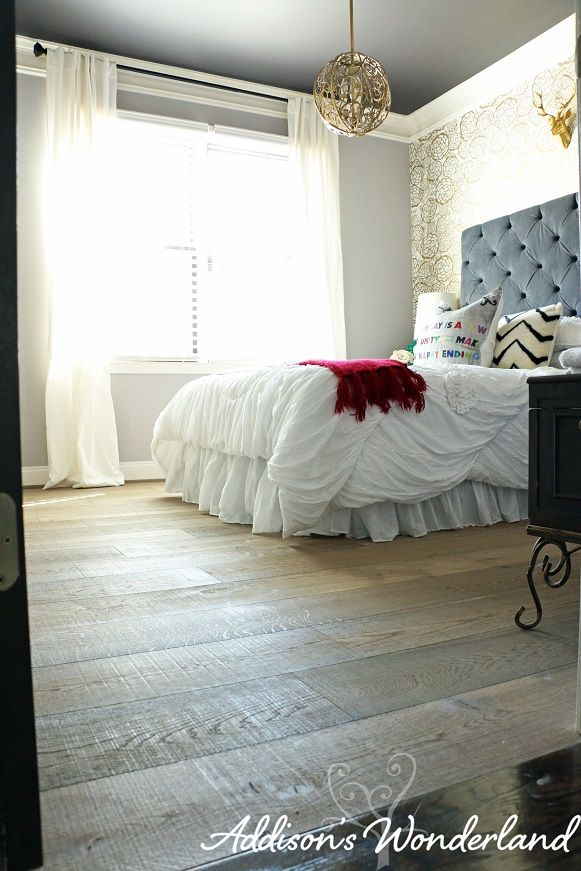 Beautiful new white oak hardwood flooring installation.  This combination of wide plank wood flooring and accessories from HomeGoods creates a rustic, hotel chic look.  The dark ceiling and light walls also creates a sense of height in this space.