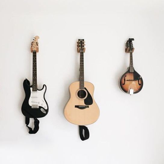 Hang your guitar or ukulele on the wall with one of our molded plywood guitar hooks. Modern guitar wall hanger. Walnut, Oak, Teak or Cherry. Made in the USA.