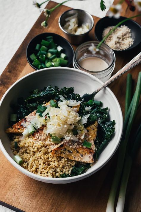 Sesame kale macro bowl with quinoa, tofu, and onions