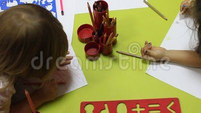 Preschoolers to kindergarten during educational activities - drawing with crayons.