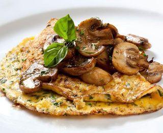 Mushroom Omelets - butter-flavored cooking spray, fresh wild mushrooms, scallions, fine herbs, fresh flat-leaf parsley, freshly ground pepper, liquid egg substitute (sub egg whites)