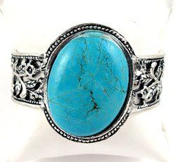"""Faux Turquoise Bracelet with Flower Filigree Design Along the Cuff White Brass 1 1/2"""" Wide Silver Pony. $26.95"""