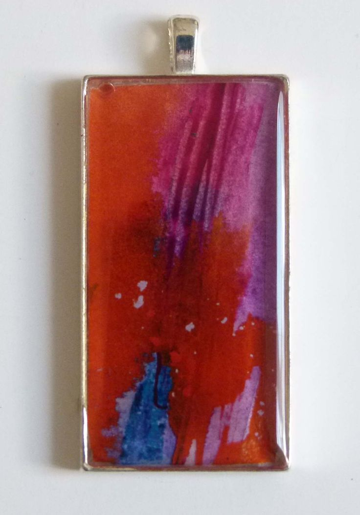 """Heatwave"" - gorgeous abstract floating colour, watercolours, a tiny original piece under a resin surface, set into a silver plated bezel.  See it at jackiesimmondsstudio - my Etsy shop"