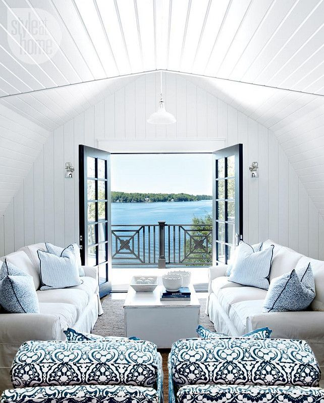 Living Room decor ideas - Coastal style lake house, white and blue color palette, wood slat ceiling, french doors overlooking Lake Muskoka.