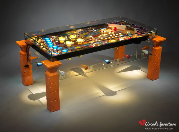A luxury coffe table from the Arcade Furniture, made from the playfield of the Earth Wind Fire pinball by Zaccharia (1987). For more information visit our website or FB page: www.arcadefurniture.com   http://www.facebook.com/pages/Arcade-Furniture/208886032582245