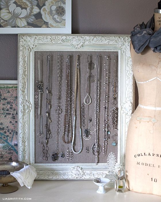 DIY:  Antiqued Frame Jewelry Display - excellent tutorial shows how Annie Sloan Chalk Paint and Wax were used to update a frame + how fabric was attached to create a jewelry display - Lia Griffith