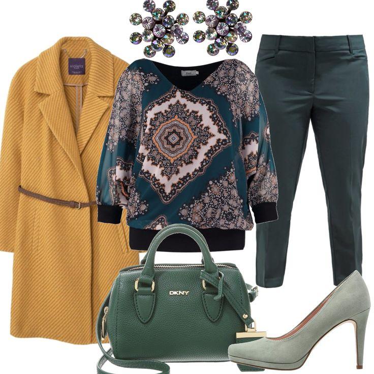 Un colore caldo ed evocativo, il curry, per il cappotto, abbinato al verde in varie tonalità che domina il resto dell'outfit. Pantalone alla caviglia, blusa con scollatura a V e stampe damascate, con un richiamo alla tonalità del cappotto. Décolleté verde menta e borsa a mano di una tonalità più scura. Per dare luce al volto, orecchini brillanti, con tonalità che richiamano tutto l'outfit.