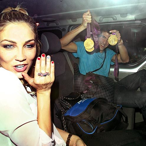 MICHAEL PHELPS  Medal count: 4 gold, 2 silver   Olympic golden boy Phelps didn't just break records in London, he also broke hearts when it came out that he was dating model Megan Rossee, who accompanies him and his medals for a night out at London's St. Barnabas club into the wee hours of Aug. 5.