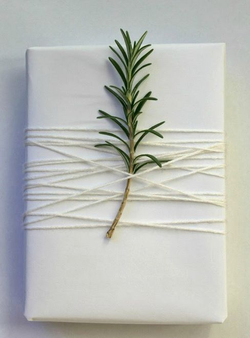 A sleek and simple wrapping job, done right. Just add a little sprig of rosemary or snip a branch off your Christmas tree and voila, chic wrap job!