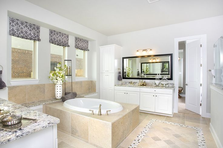 Gehan Homes Master Bathroom - Granite countertops, tan tile, mosaic telework, white wood cabinets, gray walls, brushed nickel hardware, dual sinks, apothecary jars. Austin, Texas   Pecan Creek - Villanova #Gehanhomes