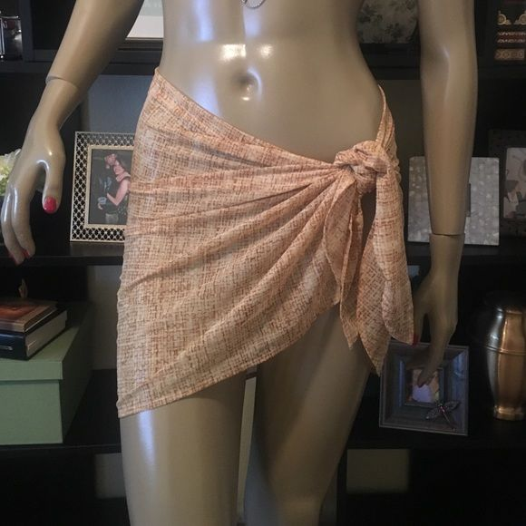 Sexy Sheer Bikini Sarong Wrap Luxurious material feels soft on skin, but also durable. Neutral tone that can be matched with any color. Sheer fabric and wrap ties on the side. Practically new. Maybe used once. Anne Cole Swim Sarongs