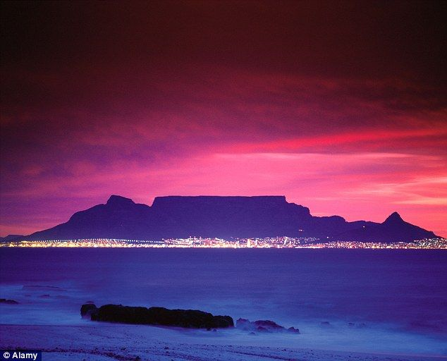 Table mountain is a flat-topped mountain creating a stunning backdrop to the South African city of Cape Town. The level plateau stretches two miles from from side to side