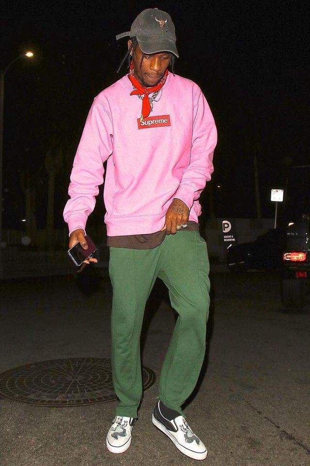 Travis Scott wearing  Supreme Box Logo Sweatshirt, Vetements Cut-out Cuff Sweat Pants, Vans David Flores Slip On Sneakers, Fan Merchandise Travis Scott Rodeo Tour Hat