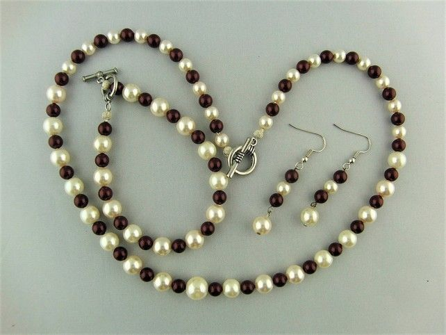 Maroon and Cream Pearl Jewellery Set Comprising a Necklace Bracelet and Earrings £25.00