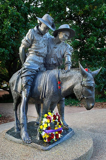 Simpson and his donkey statue at the Australian War Memorial in Canberra, ACT, Australia.
