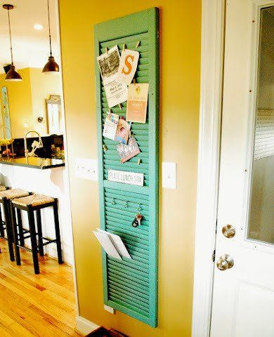 Messages, keys, cards find a convenient place to be displayed in this recycled wood shutter organizer. Envelopes and cards tuck neatly into the slots, and clothespins help secure photos, art, and assorted paraphernalia.