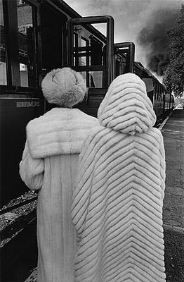 Vintage fur coats and an old train. This would be great in a striped wool instead.