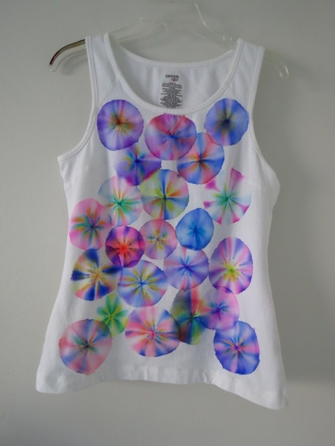 tie dye shirt with sharpies and alcohol.  looks like the little drink umbrellas.  cool for summer