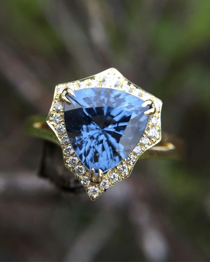 Stormy days give the best gemstone and jewelry lighting! Our Intrepide setting starring a customer's blue spinel trillion. @thegemstoneproject