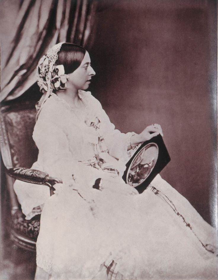 Photograph by Bryan Edward Duppa 5 Jul 1854 showing a profile portrait of a seated Queen Victoria (Alexandrina Victoria) (24 May 1819-22 Jan 1901) UK at Buckingham Palace holding a framed portrait of Prince Albert (Francis Albert Augustus Charles Emmanuel) (26 Aug 1819-14 Dec 1861) Saxe-Coburg & Gotha, Germany on her lap.