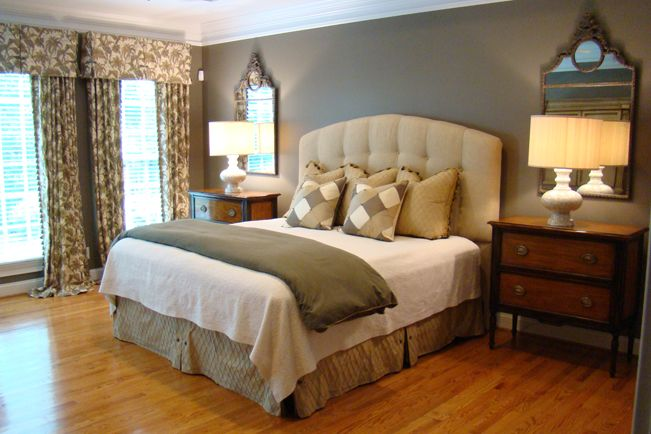 Neat idea! No decoration above bed. Mirrors over nightstands.