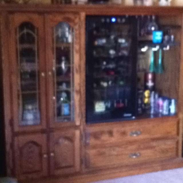 repurposed our old tv entertainment center into a wine cabinet. The ...