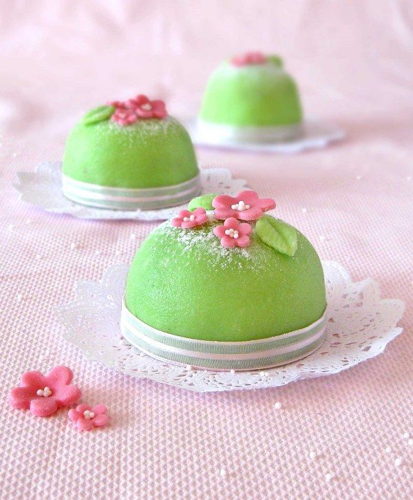 mini cupcake version of the Princess cake - a traditional Norwegian dessert, a sponge cake with raspberry jam, pastry cream, whipped cream, and marzipan dome frosting