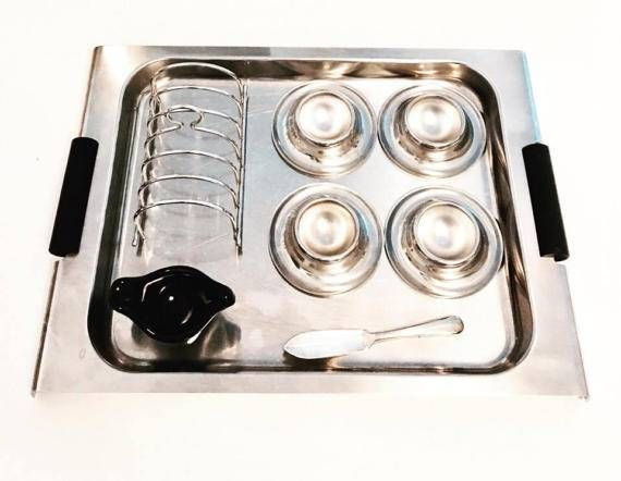 Set of 8 pieces Mid Century stainless steel breakfast, Danish tray designed by Christel Christer Holmgren signed and numbered, toast holder , 4 egg cups, mini butter dish  and butter knife.  -  toast holder for 6 pieces, pointed Made in England.  - 4 egg cup marked stainless steel 18/8, mid century modern  - small, mini butter dish or for individual jam in pottery, 7,5 cm x 5 cm x 3 cm H  - small knife marked Made in England Mayell ,12 cm L  - Danish designer Christel Christer Holmgren…