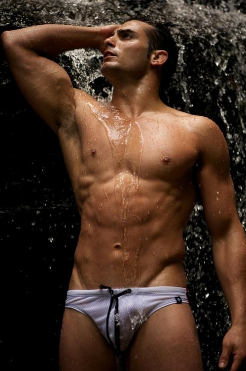 Muscular Young Sexy Wet Naked Guy Posing Near Pool In Swimwear Outdoors