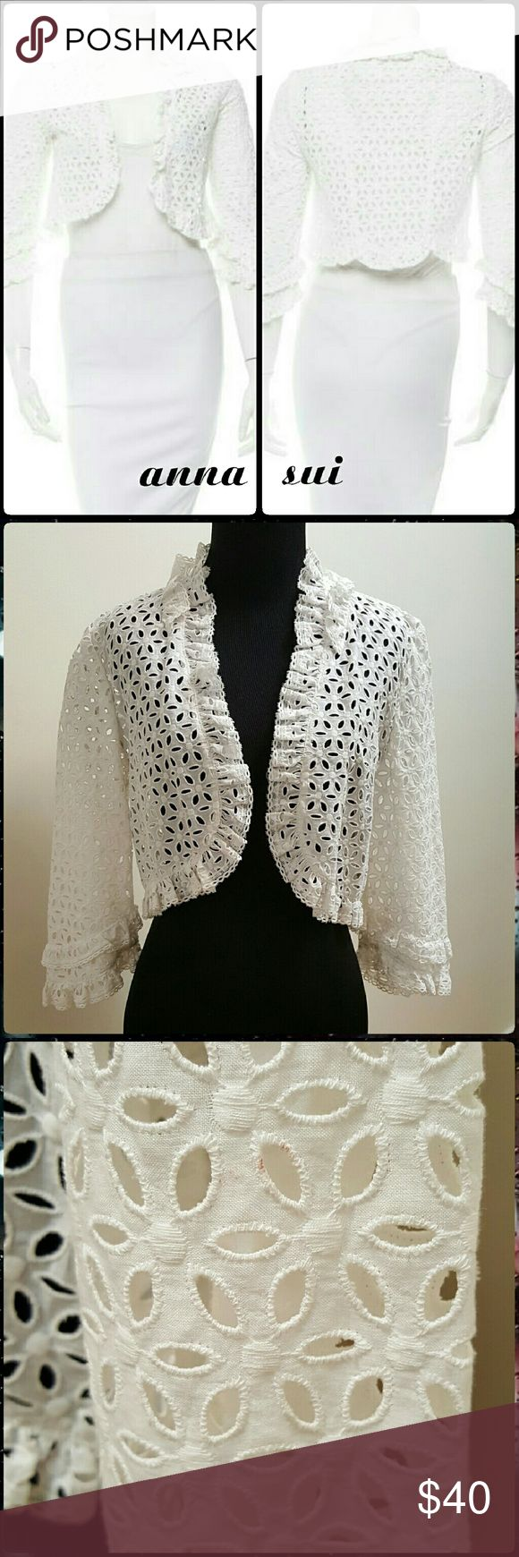 Anna Sui Eyelet Crop Jacket Sweet flower eyelets with ruffle trim on this lightweight crop cardigan. Upon very close inspection I found a minute mark, hardly noticeable on the edge of one of the eyelets by side arm. See photo. Runs on small side Anna Sui Jackets & Coats