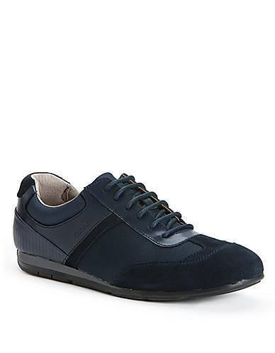 A sleek and modern casual sneaker with mixed layered materials by Calvin Klein. Featuring a nylon; suede and leather upper with a rounded toe; lace-up vamp and logo-debossed sides. More Details