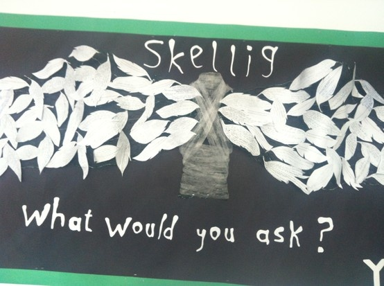 Skellig wall display by Fiona Bradford. Each feather is work by a pupil.