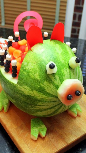 Watermelon and Cantaloupe Pig Art Carved Fruit - Grilling Time Side Dish... for a Southern Style BBQ Party. This little guy is so easy to do... All you need is a knife, a Melon baller, some construction paper and a few toothpicks. This little guy would be a welcome guest at any BBQ