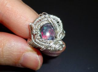 "Ring ""Echoes"" Black Opal wrapped in Sterling Silver"
