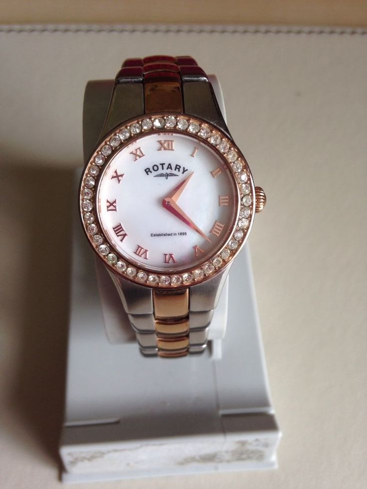 This elegant watch is part of the Rotary collection. Both the case and links bracelet have been expertly crafted from two tone stainless steel to give a beautiful rose gold and silver effect. The watch face has sophisticated roman numerals at each hour and has been surrounded by sparkling stones. | eBay!