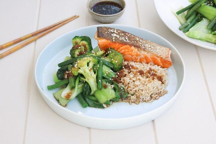 Ingredients: 4 (120g) salmon fillets (skin on) 2 teaspoons Extra Virgin Olive Oil 1 tablespoon freshly grated ginger 1 teaspoon sesame oil 2 teaspoon brown sugar ¼ cup (60mls) light soy sauce salt and cracked pepper 1 head broccoli, cut into small florets 1 bunch of bok choy, bottom cut and leaves separated 2 cups