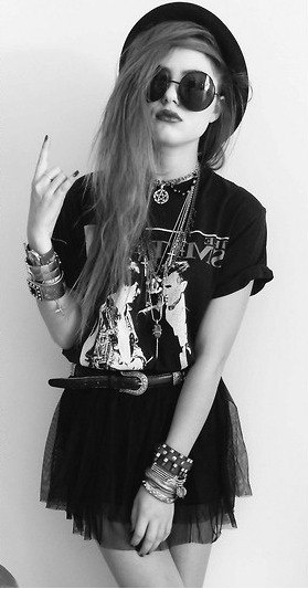 Rock tee, belted black skirt, hipster hat, sunglasses and piled on jewelry.