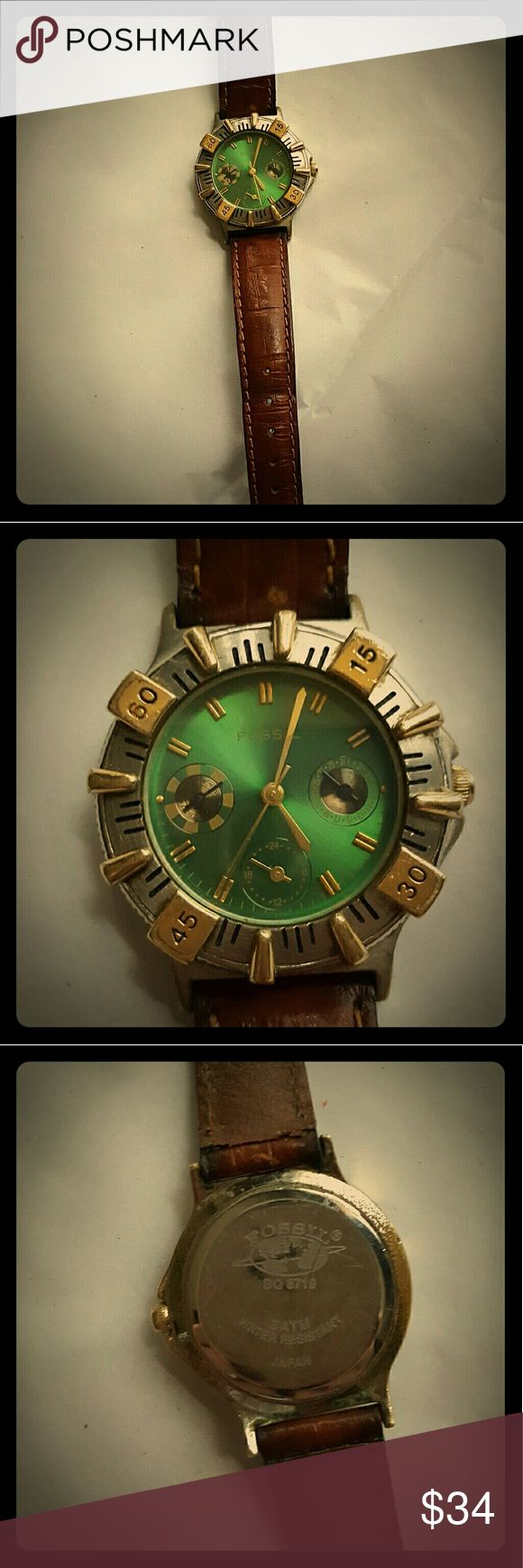 Fossil watch green and gold. This is a vintage Fossil watch with a green face and brown leather band. Fossil Accessories Watches