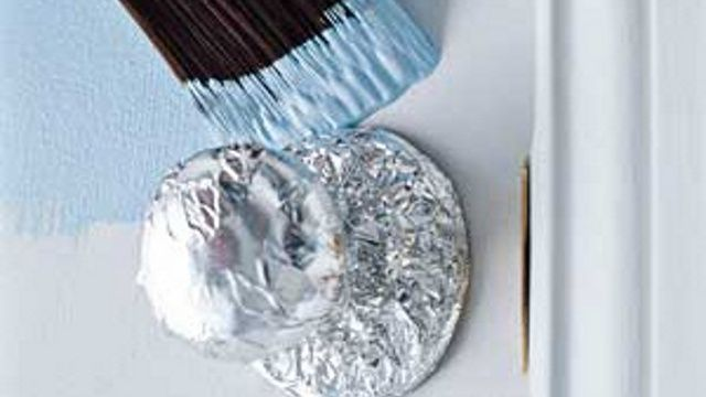 Protect Door Fixtures from Paint with Aluminum Foil -- I am totalling doing this.  What this tip doesn't say is that you should let foil over lap onto door -- then use a sharp blade to cut off excess to get a perfect fit on the door knob...