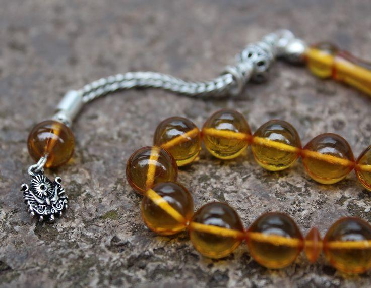 Gümüş Püsküllü Sarı Sıkma Kehribar Tesbih  Fyat: 119, 90 €  Telefonnummer: +49 (0) 203 - 935 40 700 Mail: info@tesbihane.eu