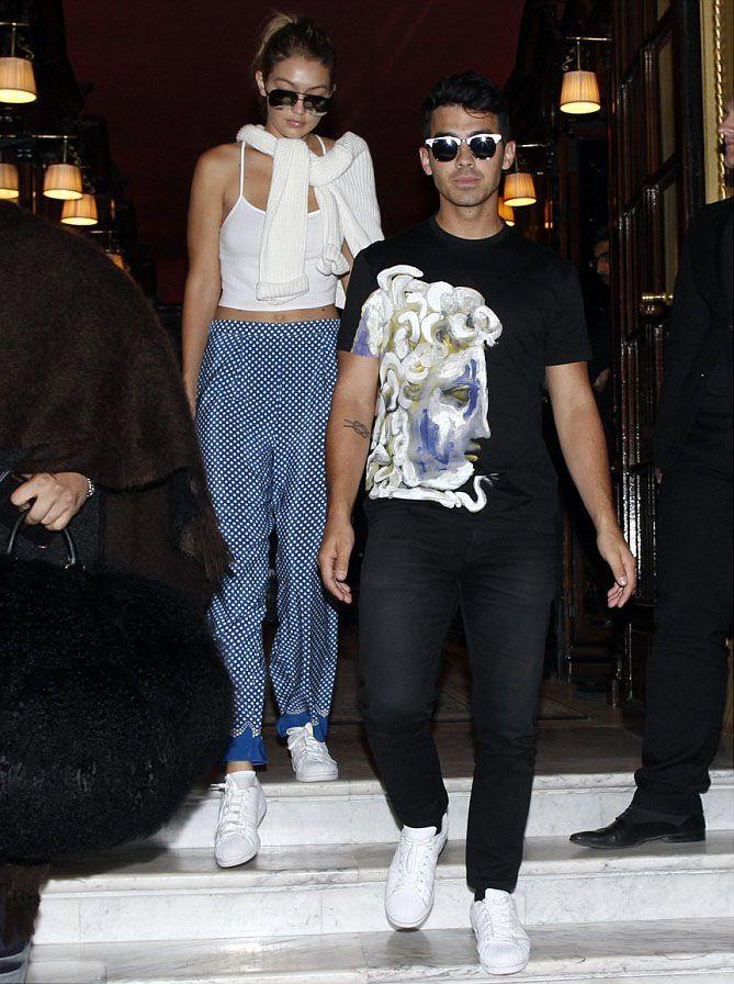 Gigi Hadid and Joe Jonas go on a stylish date in Paris  #gigihadid #joejonas #versace #tee #tshirt #superstarsneakers #adidasoriginals #paris #annasui #trousers #pants #ProenzaSchouler #bag #victoriabeckham #sunglasses