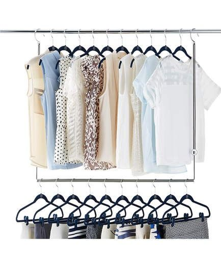 Closet Solutions | There isn't much you can do about the size of your room, but tools like this make it a little bit easier to organize your space. This space-saver is especially crucial if you share that valuable closet space with your roommate. It doubles your closet's capacity by providing a second rod to hang another row of clothes.