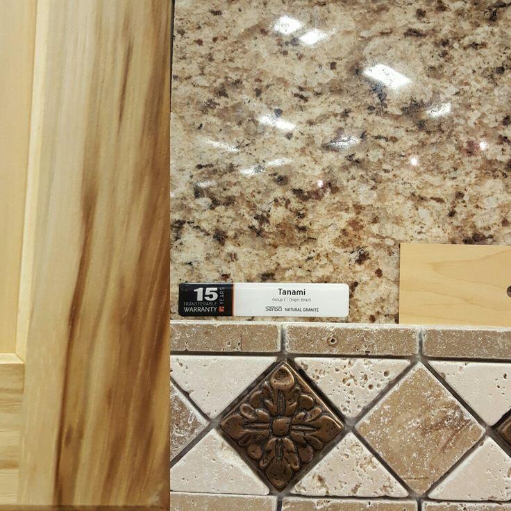 Hickory floor, tanami granite countertops, chiaro and noce tumbled travertine backsplash, maple cabinets.