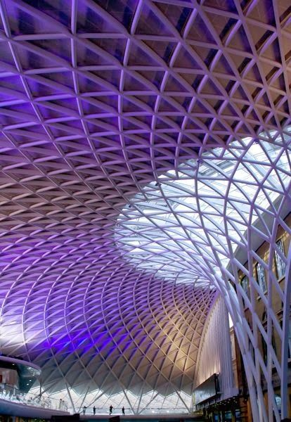 King's Cross Railway Station, London. King's Cross railway station is a major London railway terminus, opened in 1852. It is on the northern edge of central London, at the junction of Euston Road and York Way, in the London Borough of Camden. It is the southern terminus of the East Coast Main Line, one of Britain's major railway backbones. Some of its most important long-distance destinations are Leeds, Newcastle and Edinburgh. It also hosts outer-suburban services to Beds, Herts & Cambs.