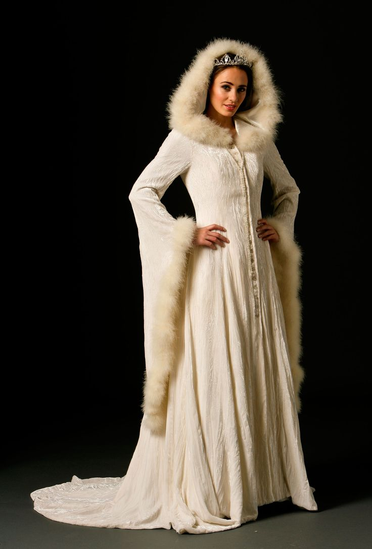 Sweeping long coat of winter-white crushed silk velvet. Full skirt with train, medieval bell sleeves, hood, and marabou trim. From Joyce Young by Storm.