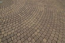 Paver (flooring) - Wikipedia, the free encyclopedia Postwar paving: capacity of pavers historically to withstand certain demainds that concrete and asphalt could not meet.