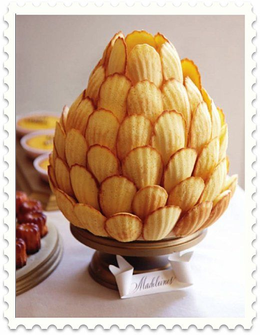 "Madeleine ""Cake"" - using a craft foam base (cut into a pineapple shape), covered in rolled fondant.  Attach each Madeleine with a skewer (starting from the bottom).  <3"