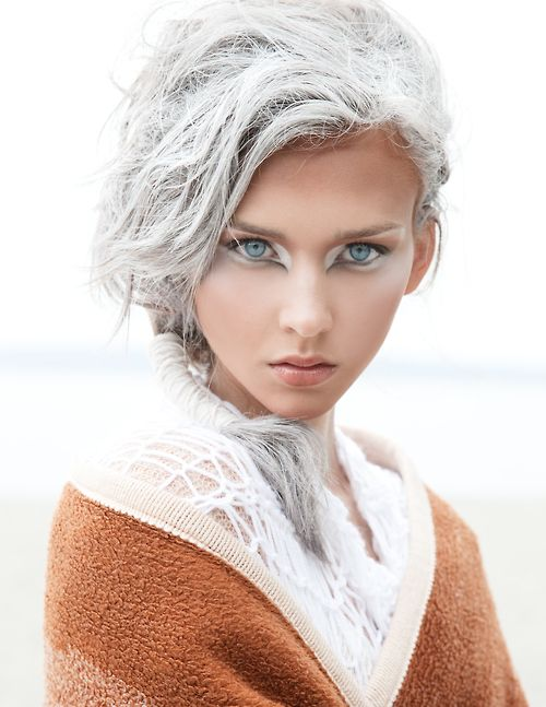 White eyeshadow creating a stunning visual effect around the piercing blue eyes, very owl like.    Makeup Artist: Brian Dean  Photographer: Natalia Borecka